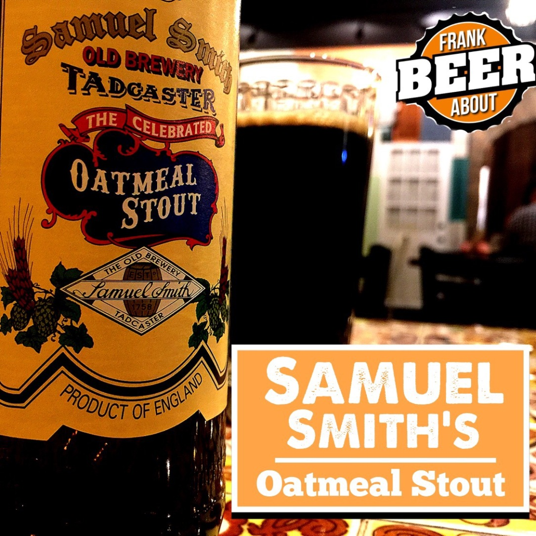 A pint glass of Samuel Smith's oatmeal stout craft beer