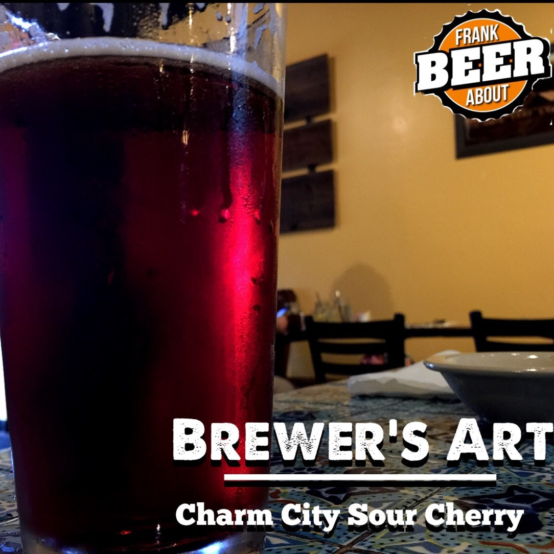 Pint glass of Brewers Art Charm City Cherry craft beer
