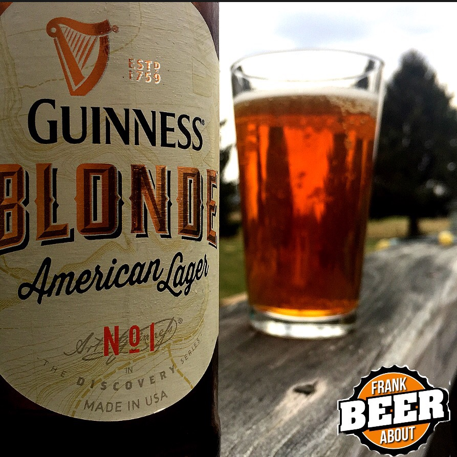Pint glass and bottle of Guinness American Blonde Lager craft beer