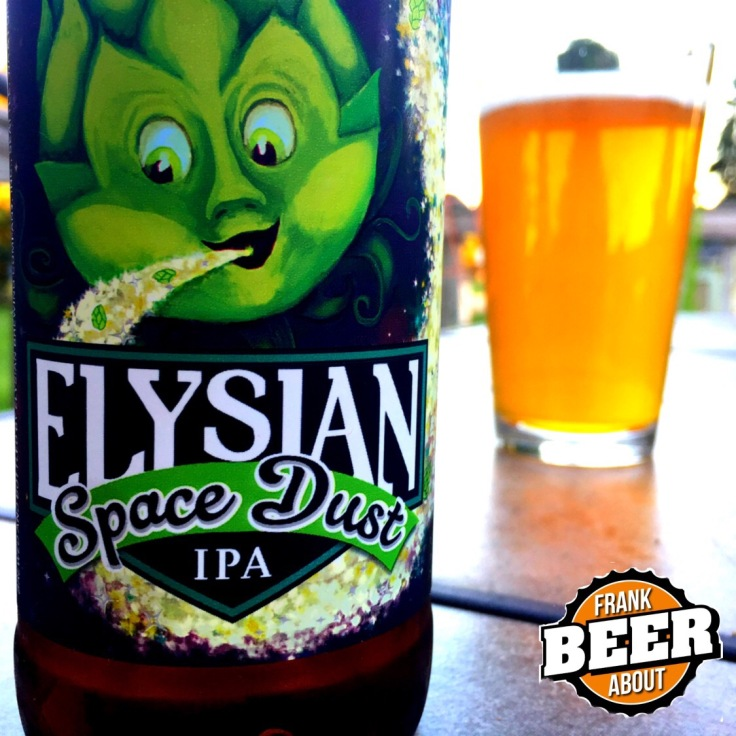 Pint glass of elysian Space Dust IPA craft beer